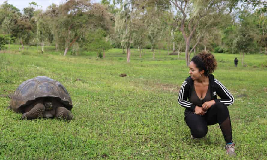 Georgina, pictured with a giant tortoise, on a trip to the Galápagos Islands.