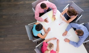 Five businesspeople at boardroom
