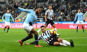 Raheem Sterling of Manchester City is thwarted by Jamaal Lascelles of Newcastle United.