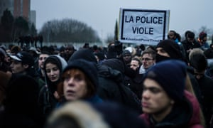 A man holds a banner reading 'Police rape' in Bobigny, a suburb of Paris