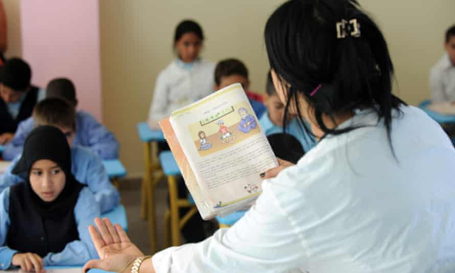 A school teacher reads a text in the ancient Amazigh language in Rabat. Amazigh was introduced in elementary classes in 2004, after King Mohammed VI set up a royal institute to promote Berber language and culture