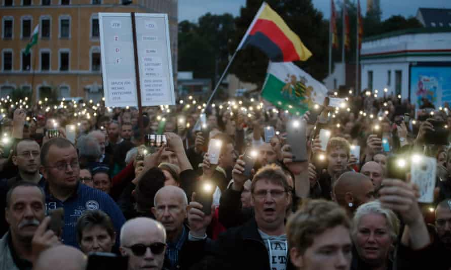 A far-right protest outside a Chemnitz addressed by the president of Saxony, Michael Kretschmer.