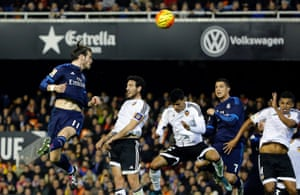 Bale heads the ball to score.