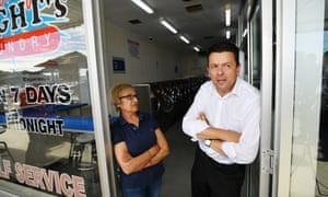 SA Best leader Nick Xenophon with a store owner outside the Campbelltown shopping centre in Adelaide on Thursday.