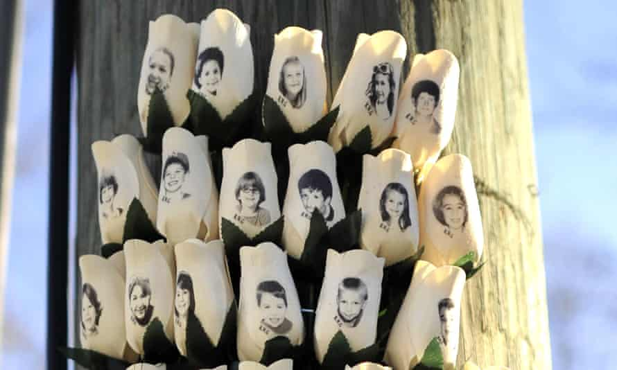 Roses with the faces of the Sandy Hook students and adults killed are seen on a pole in Newtown, Connecticut.