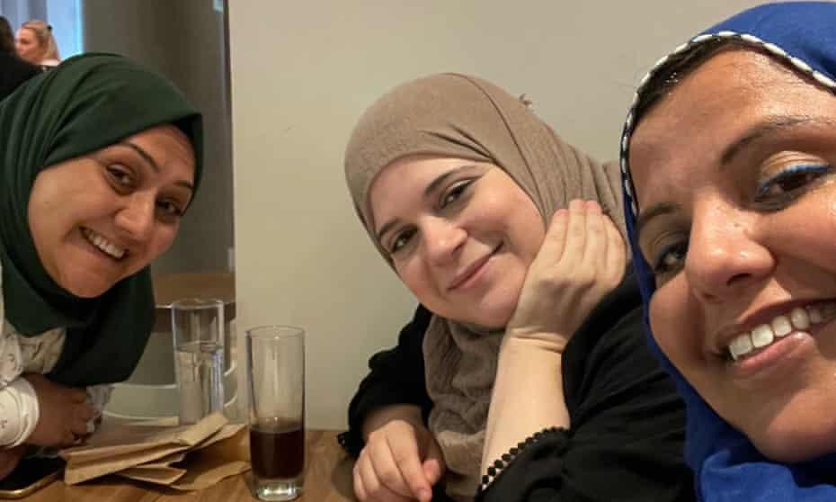 Three 'hijabis' Huda, Amna and Shaista watching the England match