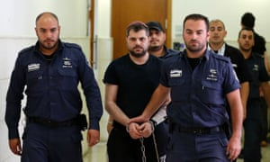 Yosef Haim Ben-David (C) is escorted by Israeli policemen at the district court in Jerusalem on 3 May 2016