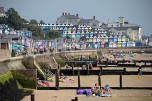 People sunbathing in Walton on the Naze, Essex.
