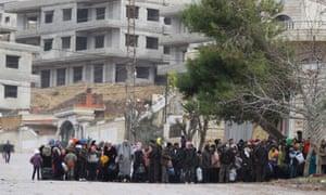 Residents of Madaya await an aid convoy