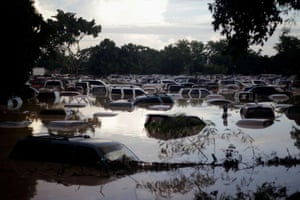 La Lima, HondurasVehicles are submerged at a plot flooded by the Chamelecon River due to heavy rain caused by Storm Iota