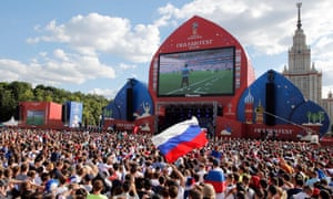 Fans watch the match between Uruguay and Russia on a big screen in Moscow