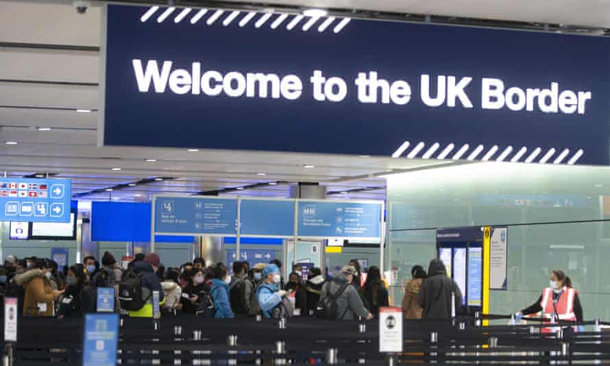 Passengers line up for passport control in the UK Border area of Terminal 2 of Heathrow Airport,