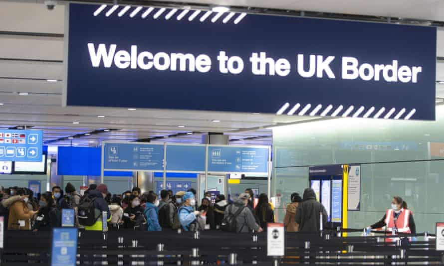 Passengers line up for passport control at Heathrow airport in London.