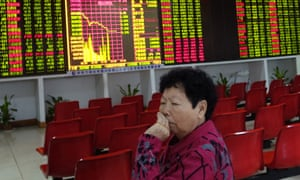 An investor in a trading hall in Haikou, capital of the southern province of Hainan on Monday after trading was suspended by a 7% fall in prices.
