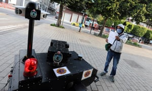 A police robot in Tunis checks the exit permit of a citizen while calling residents to respect a quarantine order.