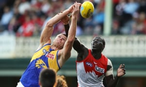Nathan Vardy of the Eagles and Aliir Aliir of the Swans compete for the ball at the SCG.