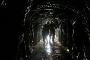 Anne and John using flashlights in the disused quarry tunnell.