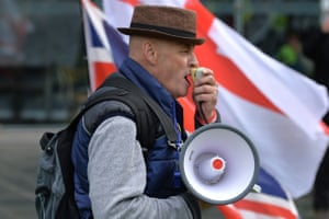 A pro-Brexit demonstrator speaks on a loudspeaker during the 'Stop The Coup' protest, in Cathedral Gardens in Manchester
