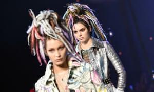 Models Bella Hadid (L) and Kendall Jenner wear Marc Jacobs pastel dreadlocks during New York fashion week 2106.