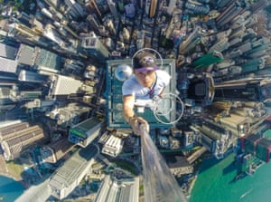 Hong Kong, China A roof-topping enthusiast takes a selfie from a 73-storey skyscraper. 'I'm an explorer,' says Daniel Lau, one of three people who climbed to the top of The Center in Central District. Lau, a student, says: Roof-topping was a getaway from my structured life. Before doing this, I lived like an ordinary person, having a boring life. I wanted to do something memorable. I want to let people see Hong Kong from a new perspective'