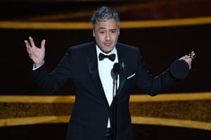 """Taika Waititi accepts the award for Best Adapted Screenplay for """"Jojo Rabbit"""" during the 92nd Oscars."""
