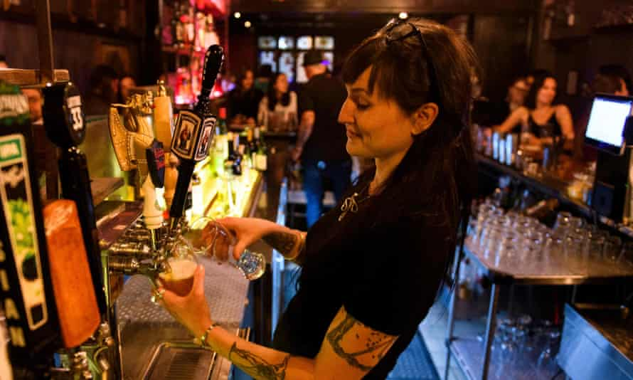A bartender pours beers at the Risky Business in Los Angeles on 21 May.