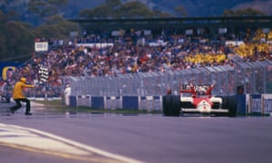 Alain Prost takes the chequered flag in Adelaide