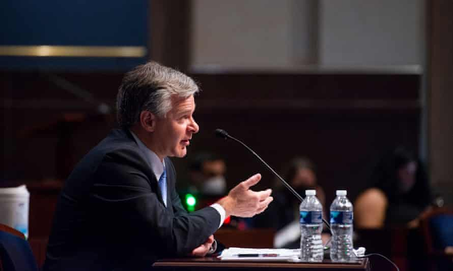 Christopher Wray appears before lawmakers at the US Capitol.