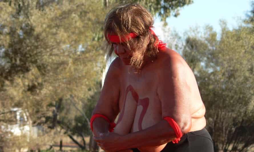 Indigenous Anangu elder Alison Hunt performs a snake dreaming dance.