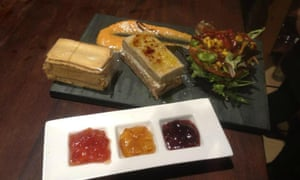 Food on a slate and a selection of sauces in a mini-tray at restaurant Arxiduna in Archidona, Andalucía