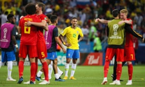 Neymar reacts as the Belgium players celebrate.