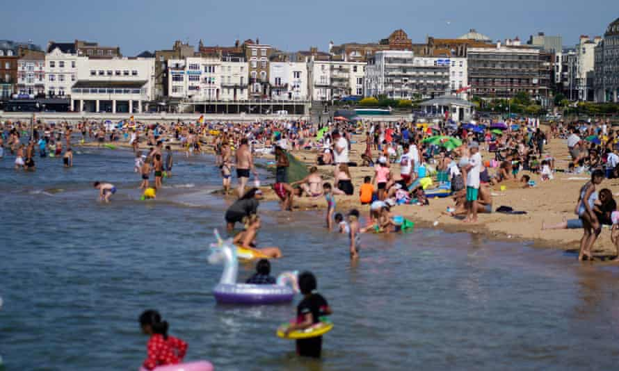 People on the beach in Margate, Kent, in hot weather, June 2020.
