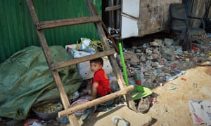A child plays among rubbish in the slums of Stung Meanchey, Phnom Penh.