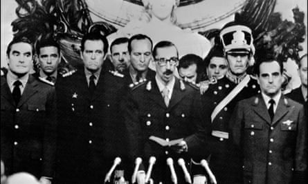 General Jorge Videla, centre, is sworn in as president in Buenos Aires on 30 March 1976, four days after the coup.