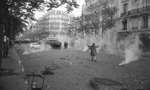 A young woman challenging the riot police in Paris in May 1968
