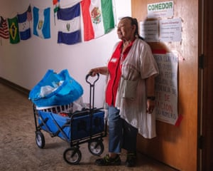 A volunteer stands outside the dining room at Casa Alitas, a center where asylum-seekers can get fresh clothes, meals and food for the journey ahead.