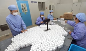 Chloroquine phosphate being packed at a pharmaceutical factory