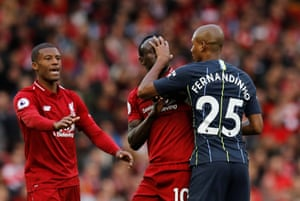 Fernandinho and Mane clash.