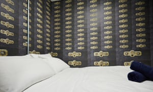 Double bed and safety deposit box wallpaper