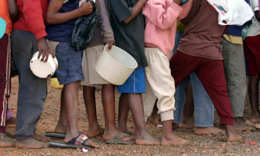 Aids orphans queue for food at a kindergarten in Manzini, Swaziland