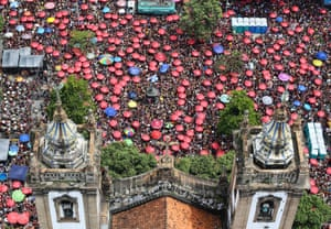 Rio de Janeiro, Brazil: Thousands of people join in with a performance by the Fogo e Paixão troupe in advance of the annual carnival celebrations