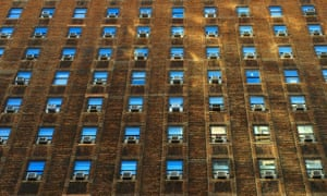 air conditioners on windows in city building