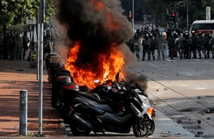 Motorbikes are on fire after they were hit with a molotov cocktail.