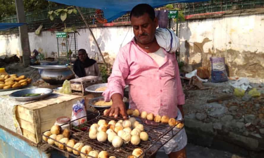 A street vendor in Patna prepares litti chokha, stuffed wheat flour balls.