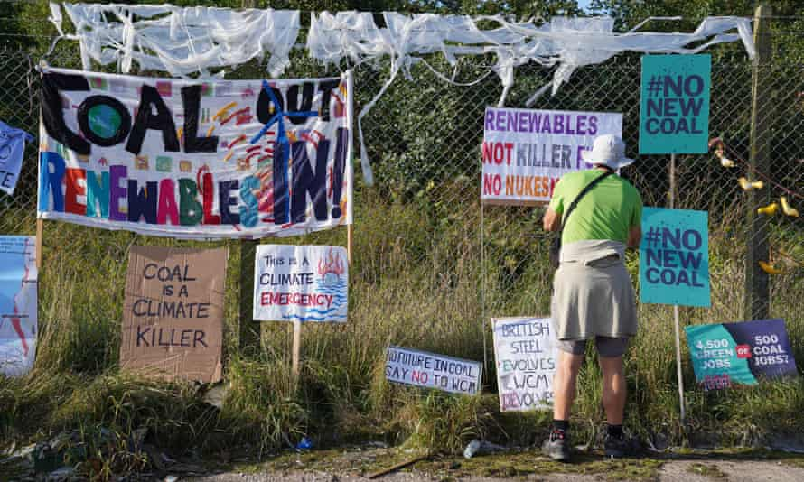 A protester outside the proposed site of Woodhouse Colliery, south of Whitehaven in Cumbria