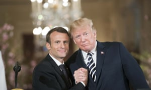 'Arm wrestle, Frenchie? You know there's only one winner' … Macron and Trump.