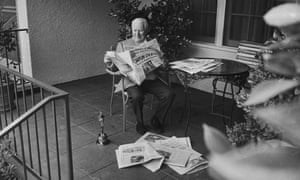 Chaplin reading the papers the morning after his Academy Award win for Limelight, in 1972.