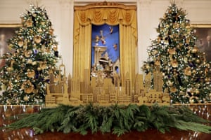 Four 14ft noble fir trees with 72 handmade paper ornaments in the White House