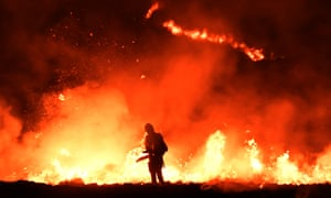 A firefighter tackles the blaze on Saddleworth Moor