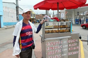 'It's the place for people with nothing' … Javier Duque selling arepas in the district of Ciudad Bolívar.